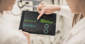 Enterprise Imaging software shown on ipad with two physicians
